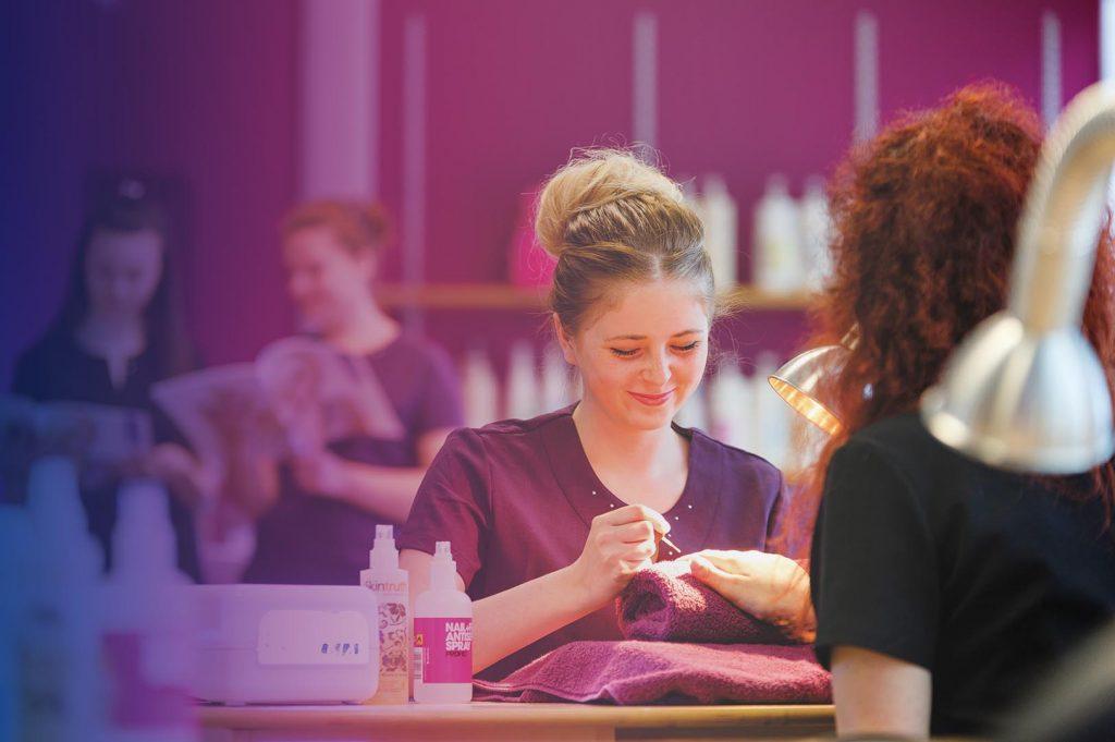 Manicurist doing a client's nails