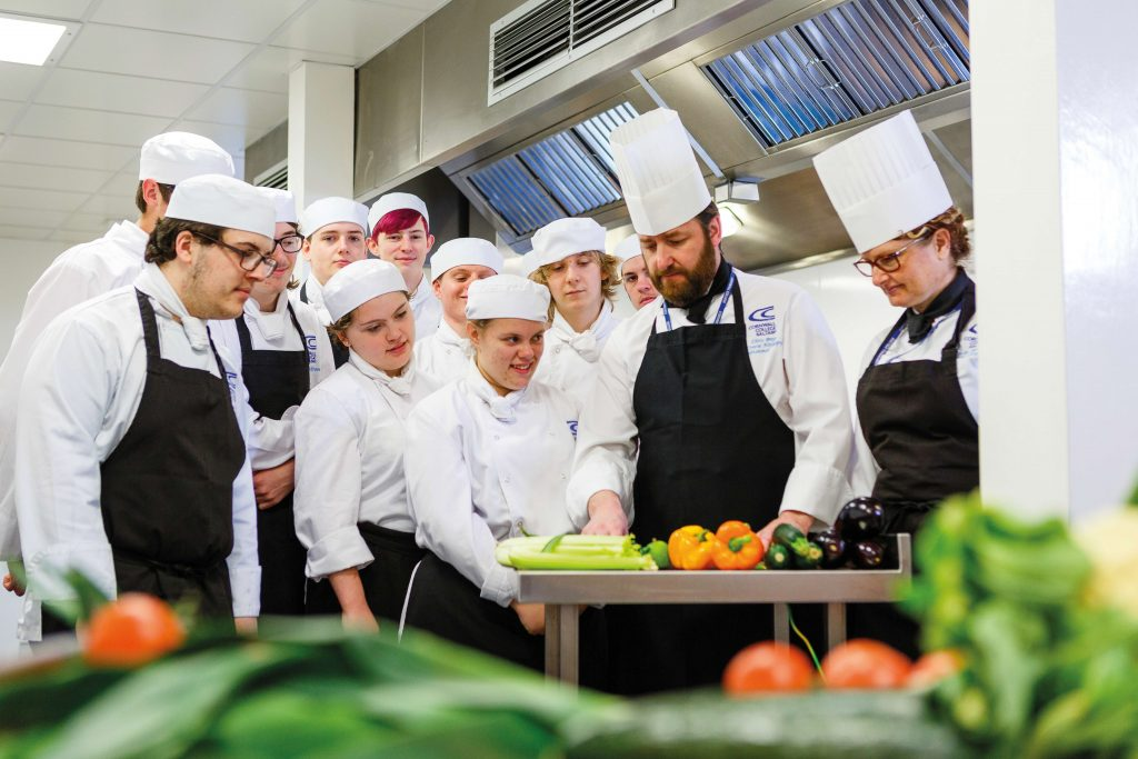 Chef cooking with students