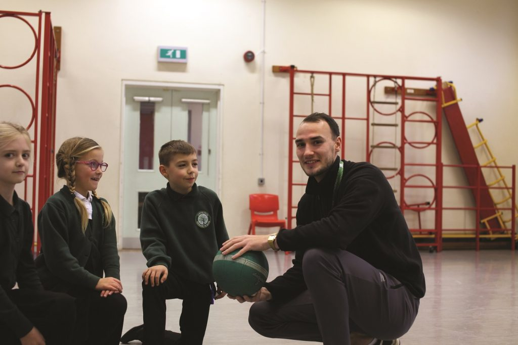 Early years teacher apprentice with students
