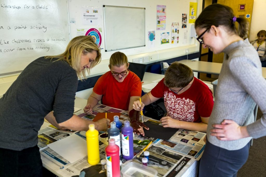 Foundation learning students during a painting activity in the classroom