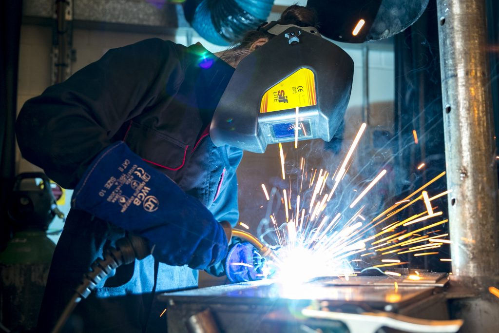 Person using an electric welding machine